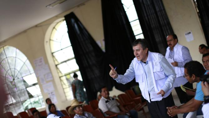 President of the National Human Rights Commission (CNDH) Luis Raul Gonzalez Perez speaks during a meeting with the relatives of the 43 missing students in Guerrero
