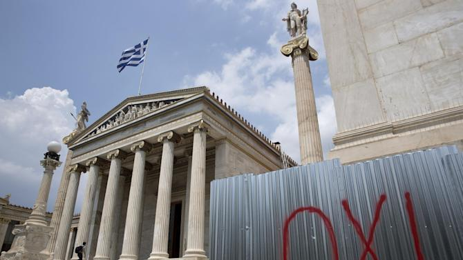 """The word """"NO"""", referring to the upcoming referendum, is written in red paint outside the Athens Academy building on Tuesday, June 30, 2015. Greek Finance Minister Yanis Varoufakis confirmed that the country will not make its payment due later to the International Monetary Fund. Capital controls began Monday and will last at least a week, an attempt to keep the banks from collapsing in the face of a nationwide bank run.(AP Photo/Petros Giannakouris)"""