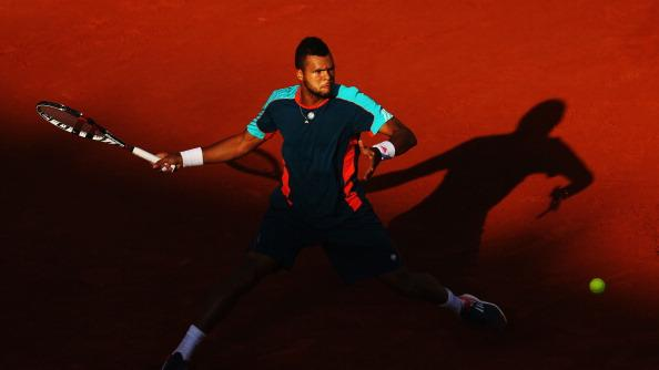 Jo-Wilfried Tsonga of France plays a forehand in his men's singles fourth round match against Stanislas Wawrinka of Switzerland during day 8 of the French Open at Roland Garros on June 3, 2012 in Paris, France. (Photo by Clive Brunskill/Getty Images)