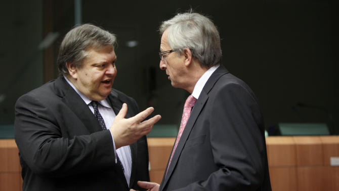 Greek Finance Minister Evangelos Venizelos, left, speaks with Luxembourg's Prime Minister and head of the eurogroup Jean-Claude Juncker during a meeting of EU finance ministers in Brussels on Monday, Jan. 23, 2012. European finance ministers will try on Monday to give new momentum to talks on a Greek debt relief deal that is crucial to avoid a default, but a European diplomat warned that a final agreement may have to wait until a leaders' summit next week. (AP Photo/Virginia Mayo)
