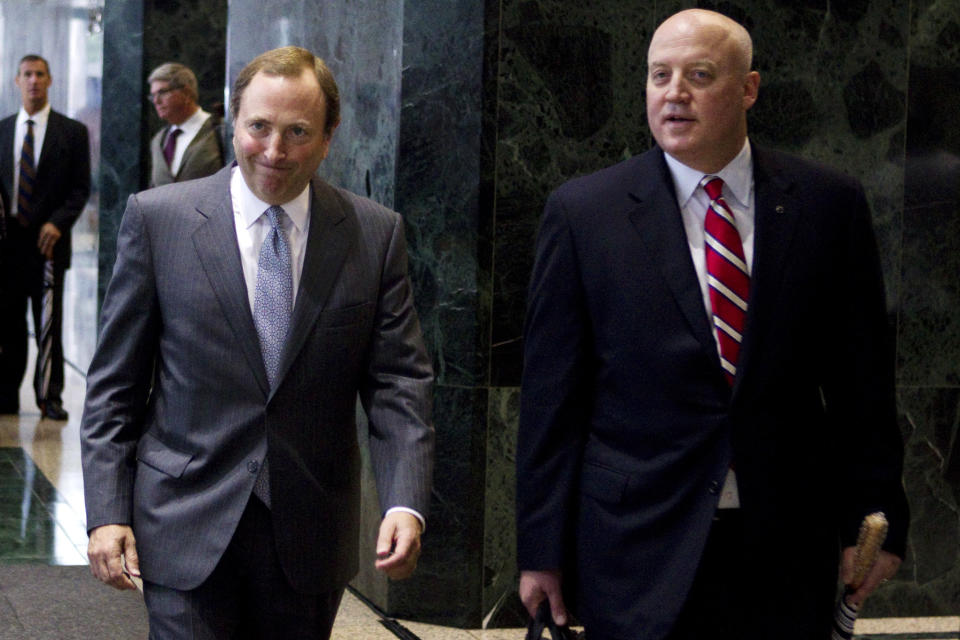 NHL Commissioner Gary Bettman, left, and Bill Daly, deputy commissioner and chief legal officer, make their way to speak with reporters following collective bargaining talks, Tuesday, Aug. 14, 2012, in Toronto. (AP Photo/The Canadian Press, Chris Young)