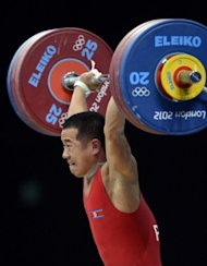 North Korea's Om Yun-Chol competes at the men's 56kg weightlifting event on July 29. The tiny, 1.52m weightlifter put North Korea on the gold trail when he lifted three times his bodyweight to win the 56kg category with a world record-equalling 293kg