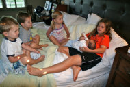 My stepdaughter with our baby and the triplets