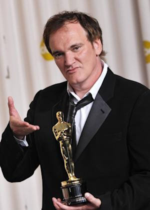 """Quentin Tarantino poses with his award for best original screenplay for """"Django Unchained"""" during the Oscars at the Dolby Theatre on Sunday Feb. 24, 2013, in Los Angeles. (Photo by John Shearer/Invision/AP)"""
