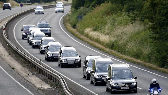 A cortege carrying the coffins of eight of the British nationals killed in the terror attack in Tunisia are driven from RAF Brize Norton near Oxford