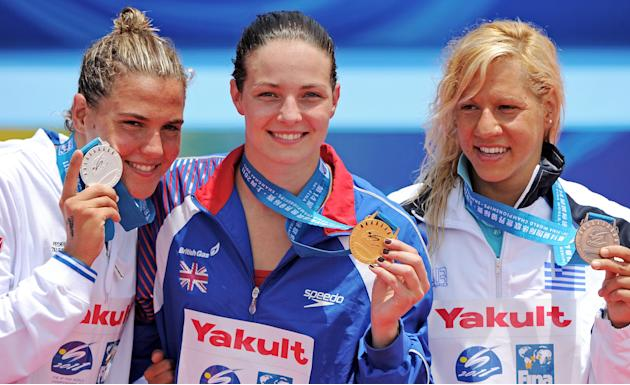 Gold medalist Britain's swimmer Keri-Anne Payne (C), silver medalist Martina Grimaldi of Italy (L) and bronze medalist Marianna Lymperta of Greece (R) pose after the women's 10km open water ev