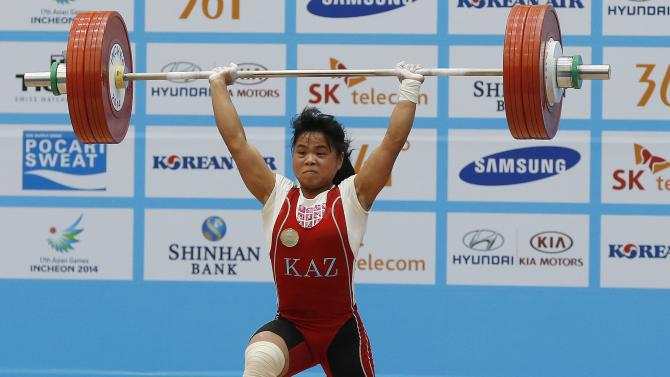 Chinshanlo breaks her own world record for the clean and jerk on her second attempt in the women's 53kg weightlifting competition during the 17th Asian Games in Incheon