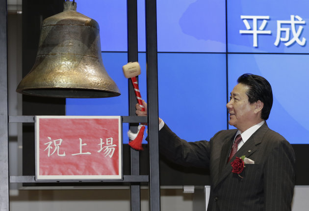 Japan Airlines President Yoshiharu Ueki rings a bell during a ceremony to mark its relisting on the Tokyo Stock Exchange in Tokyo, Wednesday, Sept. 19, 2012. Japan Airlines Co. capped an $8.5 billion initial public offering, the biggest this year after Facebook&#39;s, with a modest return to the Tokyo Stock Exchange: Its share price rose only 1 percent in the first day of trading. (AP Photo/Shizuo Kambayashi)