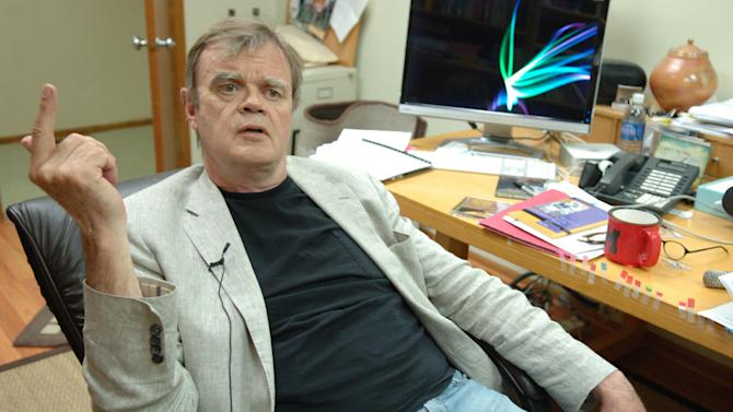 """FILE - In this Sept. 16, 2009 file photo, radio show host Garrison Keillor speaks in his Prairie Home Productions office in St. Paul, Minn. Keillor kicks off his 26-city """"Radio Romance Tour"""" July 8 in Spokane, Wash. The shows will offer more than two hours of duet singing, plus Keillor's Guy Noir Private Eye, poetry and the latest News from Lake Wobegon. (AP Photo/Janet Hostetter, file)"""