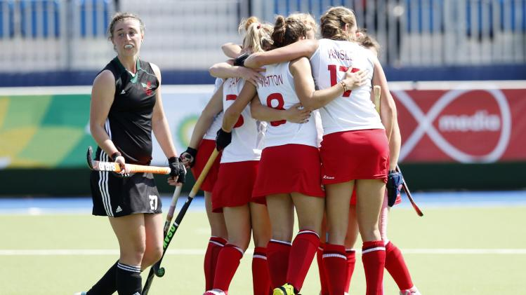 Wales' Jo Westwood walks past as England team celebrates goal scored by Nicola White during their match at the 2014 Commonwealth Games in Glasgow, Scotland