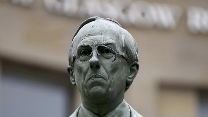 A 'Yes' campaign sticker is seen on the statue of Donald Dewar, the first Scottish First Minister, in Glasgow