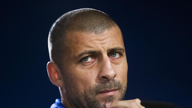 FC Basel's Walter Samuel listens to a question during a press conference ahead of Tuesday's Champions League soccer match between Real Madrid and FC Basel, in Madrid, Spain, Monday, Sept. 15, 2014