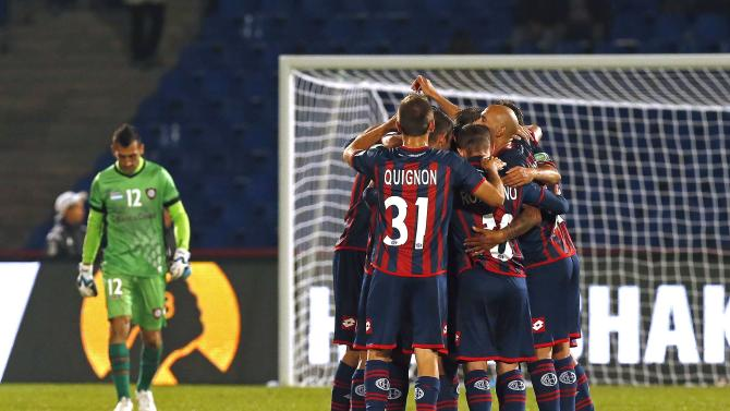 San Lorenzo team members celebrate winning their Club World Cup semi-final soccer match against Auckland City, at Marrakech stadium