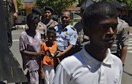 Image taken on January 29, 2013 shows Sri Lankan asylum seekers arriving in Cilacap after their boat was stranded in the waters off Java. Indonesian police have arrested 26 Sri Lankan asylum seekers who were stranded after their boat hit a reef as they tried to reach Australia&#39;s Christmas Island, an official said Tuesday