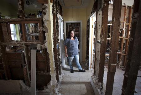 Nicole Chati poses for a portrait in what is left of her home after Superstorm Sandy in the Staten Island borough of New York