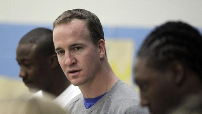 Indianapolis Colts' Peyton Manning talks with students at Frederick Douglass School during a BOKS function Friday, Feb. 3, 2012, in Indianapolis. (AP Photo/Darron Cummings)