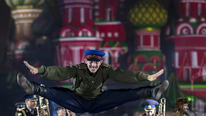 "A Russian military band member jumps during the ""Spasskaya Tower"" International Military Orchestra Music Festival at the Red Square in Moscow, Russia, Friday, Sept. 4, 2015. (AP Photo/Pavel Golovkin)"