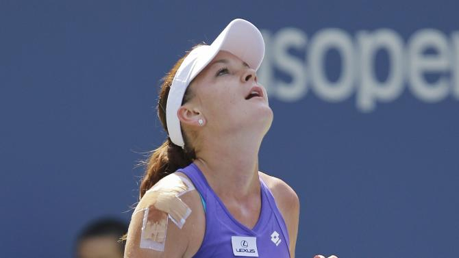 Agnieszka Radwanska, of Poland, celebrates after winning her match against Serbia's Jelena Jankovic in the third round of play at the 2012 US Open tennis tournament,  Saturday, Sept. 1, 2012, in New York. (AP Photo/Kathy Willens)