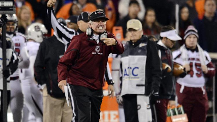 South Carolina coach Steve Spurrier reacts during the first half of an NCAA college football game against Clemson, Saturday, Nov. 24, 2012, at Memorial Stadium in Clemson, S.C. (AP Photo/Richard Shiro)