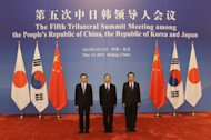 South Korea's President Lee Myung-bak (L), China's Premier Wen Jiabao (C) and Japan's Prime Minister Yoshihiko Noda pose for photos ahead of the fifth trilateral summit among the three nations at the Great Hall of the People in Beijing, on May 13