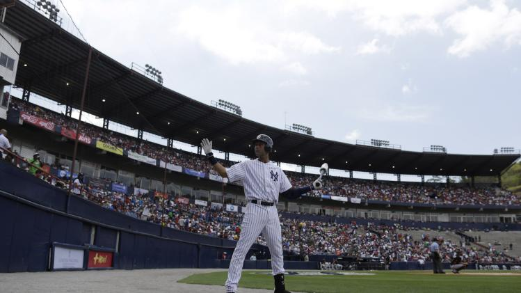 "New York Yankees' Jeter waves to fans as he warms up before batting against Miami Marlins during the first inning of the exhibition game ""Legend Series"" honoring former New York Yankees player Mariano Rivera, at the Rod Carew Stadium in Panama City"