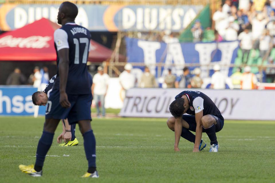U.S. players react at the end of a 2014 World Cup qualifying soccer game against Honduras in San Pedro Sula, Honduras, Wednesday Feb. 6, 2013. Honduras won 2-1. (AP Photo/Moises Castillo)