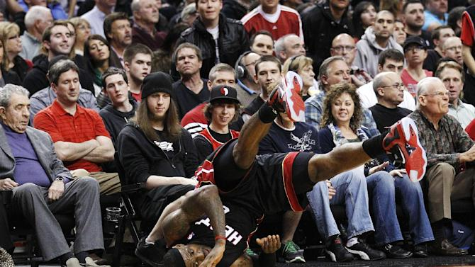 Miami Heat's LeBron James rolls over on the court during the second quarter of an NBA basketball game against the Portland Trail Blazers, Thursday, March 1, 2012, in Portland, Ore. (AP Photo/Rick Bowmer)
