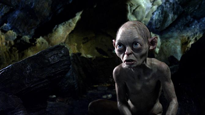 """FILE - This publicity file photo released by Warner Bros., shows the character Gollum, voiced by Andy Serkis, in a scene from the fantasy adventure """"The Hobbit: An Unexpected Journey.""""  Filmmaker Peter Jackson's decision to shoot his epic three-part J.R.R. Tolkien prequel in the super-clear format that boosts the number of frames per second to 48 from the current standard, 24, has some unintended consequences. (AP Photo/Warner Bros., File)"""