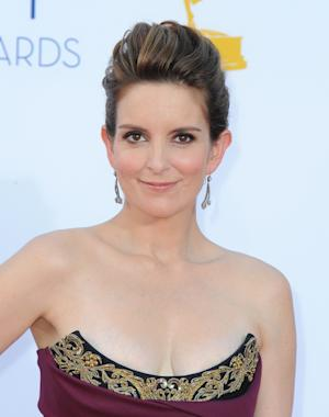 FILE - In this Sept. 23, 2012 file photo, actress Tina Fey arrives at the 64th Primetime Emmy Awards at the Nokia Theatre, in Los Angeles. The Hollywood Foreign Press Association, dick clark productions and NBC announced Monday, Oct. 15, 2012, that Tina Fey and Amy Poehler, have signed on to host the 70th annual ceremony after British comedian Ricky Gervais' three-year reign as the ceremony's acerbic master of ceremonies. The Golden Globes are set to air on NBC on Jan. 13, 2013. (Photo by Jordan Strauss/Invision/AP, File)