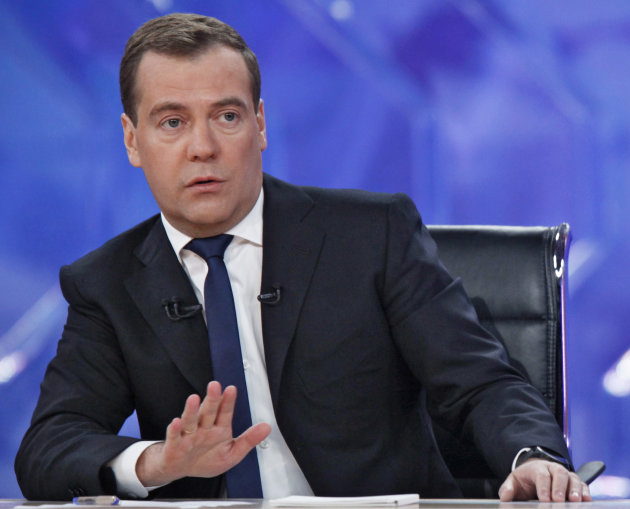 Russian Prime Minister Dmitry Medvedev speaks during live televised interview from Moscow's Ostankino TV Center on Friday, Dec. 7, 2012. (AP Photo/RIA Novosti, Dmitry Astakhov, Government Press Servic
