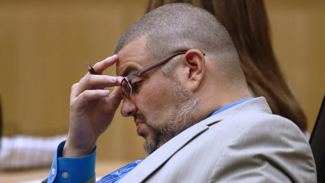 Defense attorney Kirk Nurmi listens to prosecutor Juan Martinez makes his closing arguments during the Jodi Arias trial at Maricopa County Superior Court in Phoenix on Thursday, May 2, 2013. Arias is charged with first-degree murder in the stabbing and shooting death of Travis Alexander, 30, in his suburban Phoenix home in June 2008. (AP Photo/The Arizona Republic, Rob Schumacher, Pool)