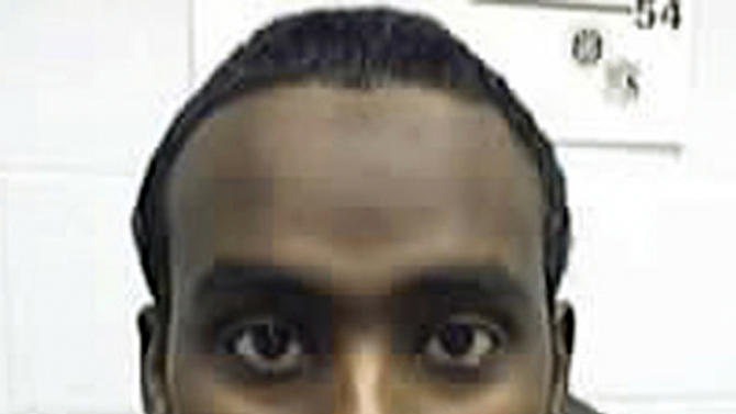 FILE - This undated file photo provided by the U.S. government shows Nuradin Mahamoud Abdi, a Somali immigrant convicted of terrorism charges in Columbus, Ohio in 2007 in a plot to bomb an unspecified area shopping mall.  Abdi has been deported to Somalia. He completed his prison sentence in August and was in federal custody in Louisiana while final preparations were made to return him to Somalia. (AP Photo/U.S. Immigration and Customs Enforcement, File)