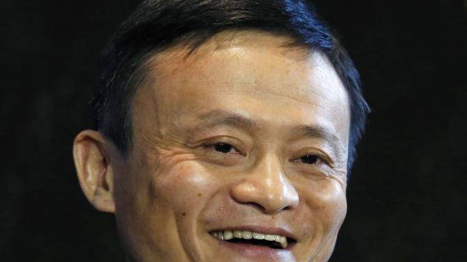 Alibaba Executive Chairman Jack Ma smiles as he speaks to journalists ahead of an IPO roadshow, inside a hotel in Hong Kong