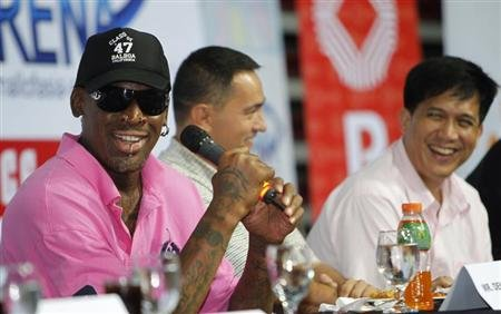 Former NBA Chicago Bulls player Dennis Rodman shares a light moment during a news conference inside a mall of Asia Arena in Manila