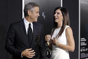 "Actors George Clooney and Sandra Bullock arrive for the film premiere of ""Gravity"" in New York"
