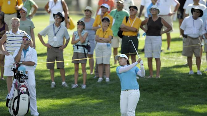 Inbee Park, of South Korea, watches her shot on the ninth hole during the third round of the LPGA Kraft Nabisco Championship golf tournament in Rancho Mirage, Calif., Saturday, April 6, 2013. (AP Photo/Rodrigo Pena)