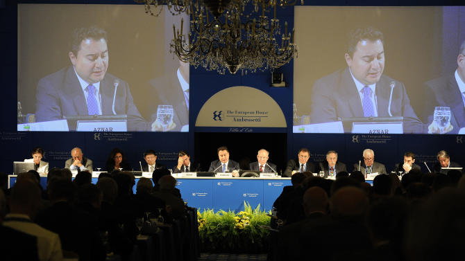 Deputy Prime Minister of Turkey Ali Babacan, center, speaks during a meeting on the world economy in Cernobbio, Italy, Friday, Sept. 7, 2012. Experts and leaders gathered in Italy to discuss the global financial crisis. (AP Photo/Giuseppe Aresu)