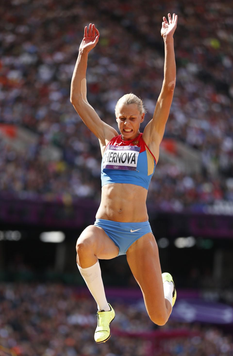 Russia's Tatyana Chernova competes in the long jump heptathlon during the athletics in the Olympic Stadium at the 2012 Summer Olympics, London, Saturday, Aug. 4, 2012. (AP Photo/Matt Dunham)