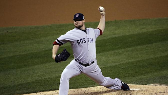 Boston Red Sox starting pitcher Jon Lester throws during the second inning of Game 5 of baseball's World Series against the St. Louis Cardinals Monday, Oct. 28, 2013, in St. Louis. (AP Photo/David J. Phillip)