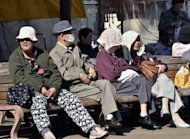 Elderly people take a rest on benches in Tokyo. The proportion of people aged 65 or over will reach nearly 40 percent of Japan's population in 2060, a government report said Friday, warning the nation's economic prospects depend on making them productive