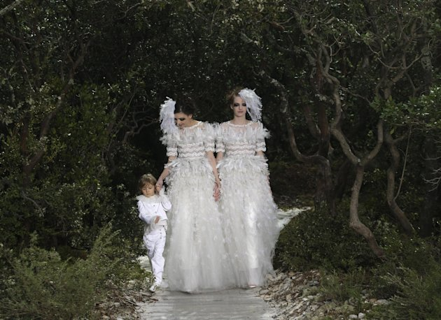 Models wear wedding gowns by German fashion designer Karl Lagerfeld for Chanel's Spring Summer 2013 Haute Couture fashion collection, presented in Paris, Tuesday, Jan.22, 2013. (AP Photo/Christophe En