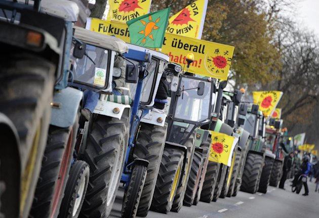 Farmers queue with their tractors near Gusborn, northern Germany, Saturday Nov. 26, 2011. They are on  their way to a demonstration in Dannenberg, to protest against the  transport and storage  of nuc