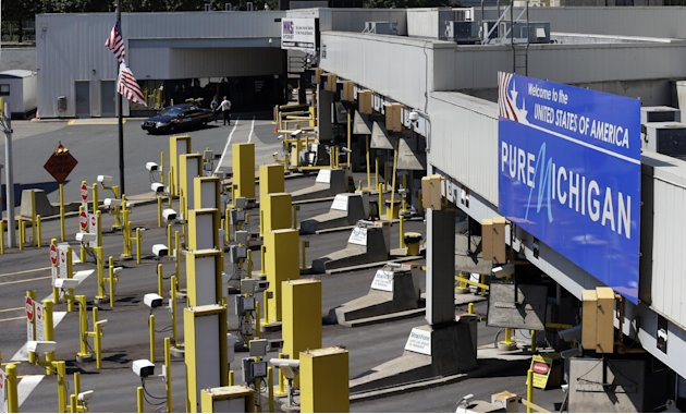 Lanes entering the United States are shown closed during an investigation of a bomb threat at the Detroit Windsor Tunnel Thursday, July 12, 2012. The tunnel was closed to traffic after the threat was 
