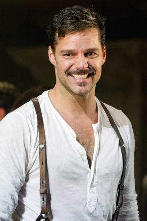 "In this Monday, March 12, 2012 photo, Ricky Martin appears at the curtain call after his first performance in the new Broadway production of ""Evita"", in New York. Martin is saying goodbye to Broadway's ""Evita,"" but the Latin superstar has a slew of projects in the works, including two television series and a children's book. (AP Photo/Charles Sykes)"