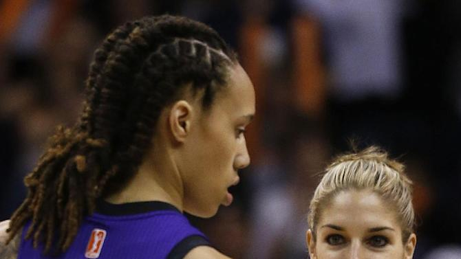 Chicago Sky's Elena Delle Donne, right, smiles as she looks at Phoenix Mercury's Brittney Griner (42) at the start of the first half during a WNBA basketball game on Monday, May 27, 2013, in Phoenix. (AP Photo/Ross D. Franklin)