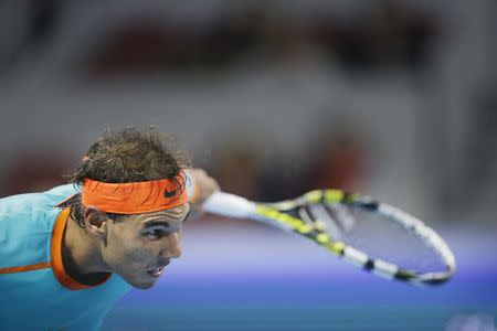 Nadal of Spain hits a return during his men's quarter-final match against Klizan of Slovakia at the China Open tennis tournament in Beijing