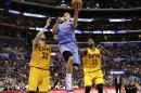 Los Angeles Clippers's Blake Griffin, center, drives to the basket past Cleveland Cavaliers's Spencer Hawes, left, and Tristan Thompson during the first half of an NBA basketball game on Sunday, March 16, 2014, in Los Angeles. (AP Photo/Jae C. Hong)