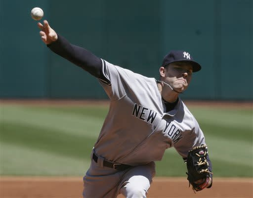 Yankees win 7-0, split doubleheader with Indians