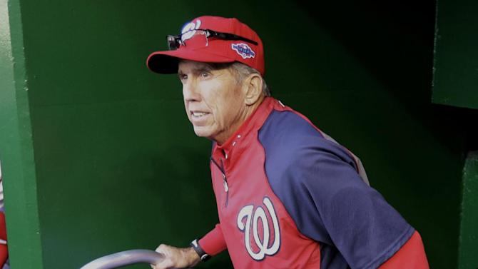 Washington Nationals manager Davey Johnson walks out of the clubhouse to the dugout before Game 4 of the National League division baseball series against the St. Louis Cardinals, Thursday, Oct. 11, 2012, in Washington. (AP Photo/Alex Brandon)
