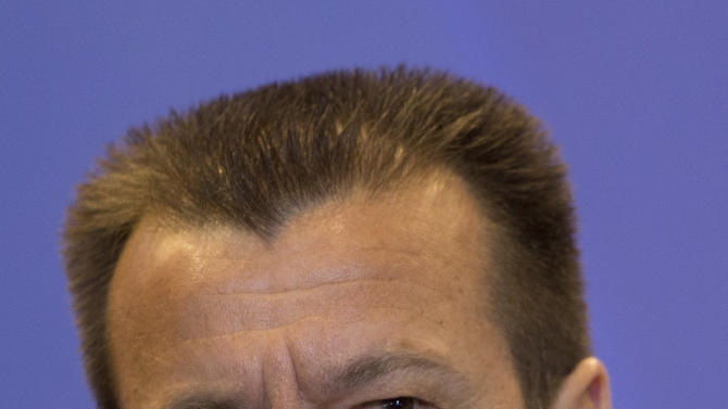 Brazil's soccer coach Dunga listens to a question during a press conference in Rio de Janeiro, Brazil, Wednesday, Sept. 17, 2014.  Dunga summoned players for upcoming friendly games with Argentina and Japan. (AP Photo/Silvia Izquierdo)